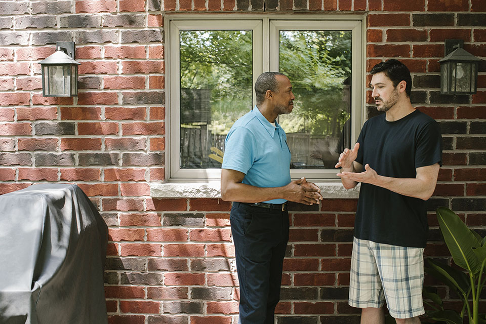A home energy auditor and a homeowner