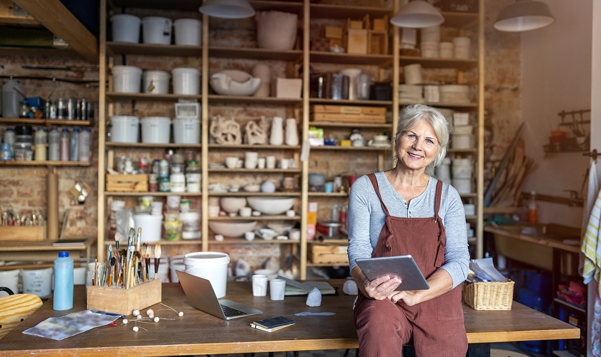 elderly female and small business owner in her pottery studio